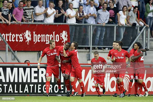 Twente players Wout Brama and Miroslav Stoch congratulate teammate Douglas as others look on after scoring 1-0 in the duel against Sporting Lisbon...