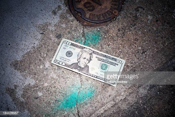 Twenty dollar bill lost on sidewalk