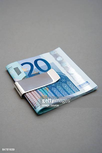 twenty euro notes in money clip - twenty euro banknote stock photos and pictures