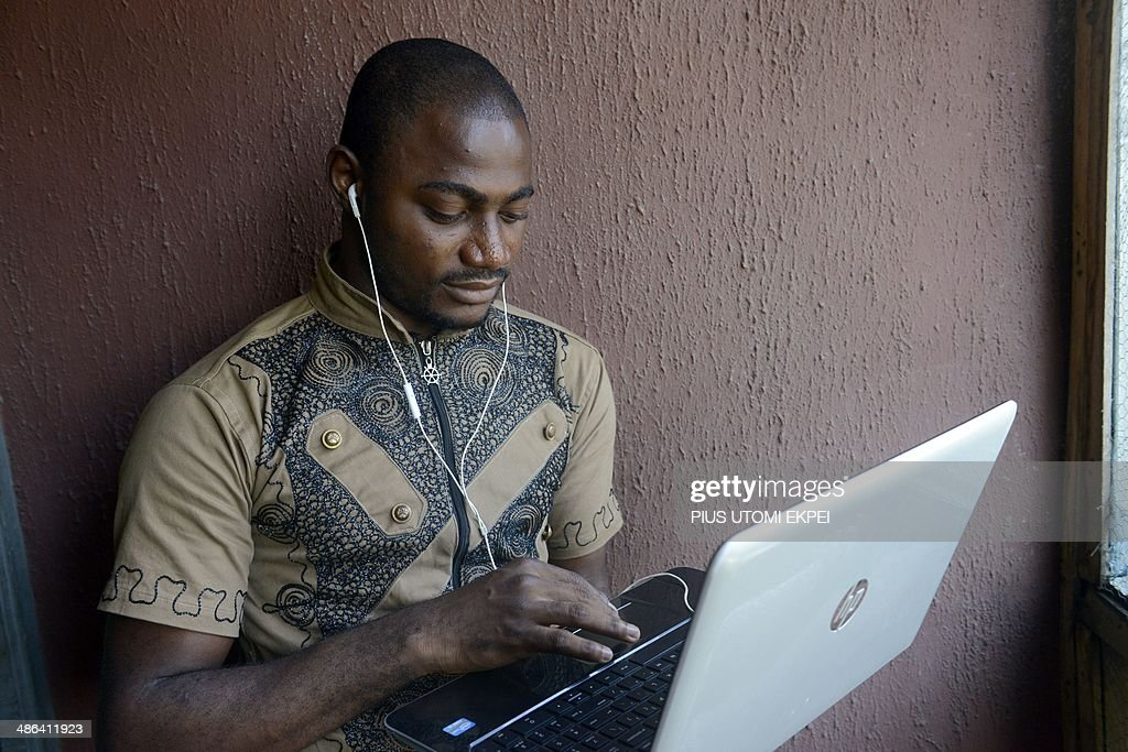 Twenty five-year-old Computer Science undergraduate Kayode Sowole holds a laptop looking at his application in Lagos on April 10, 2014. The computer science student of University of Lagos is the brains behind a series of new smartphone applications to make the word of God available in the country's four main languages at the touch of a button. With this innovation, you do not need the Internet to read the Bible, neither do you need to bring a Bible to church. 'You have it in the local language of your choice on your phone.'