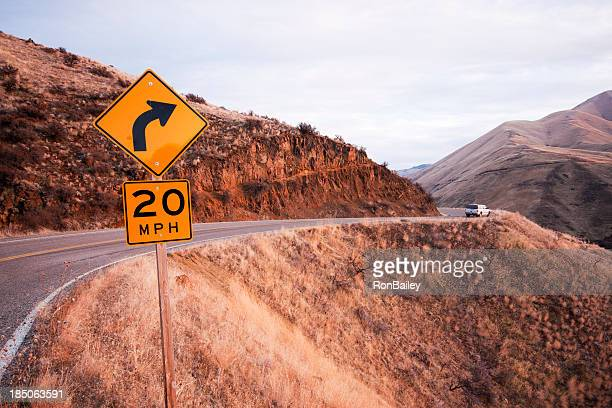 twenty mph twisty road - curved arrows stock photos and pictures