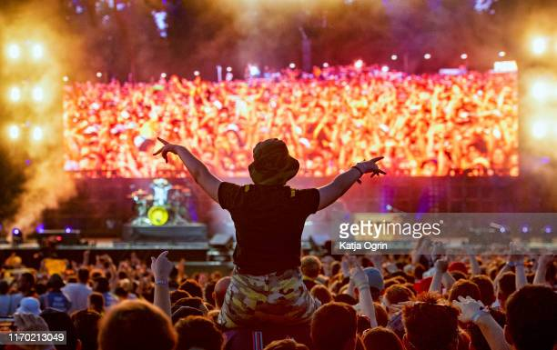 Twenty One Pilots fans enjoy the bands performance on the main stage at Leeds Festival 2019 at Bramham Park on August 25 2019 in Leeds England