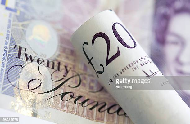 Twenty pound note sits arranged for a photograph in London, U.K., on Thursday, March 25, 2010. The pound had its biggest gain in more than a week...