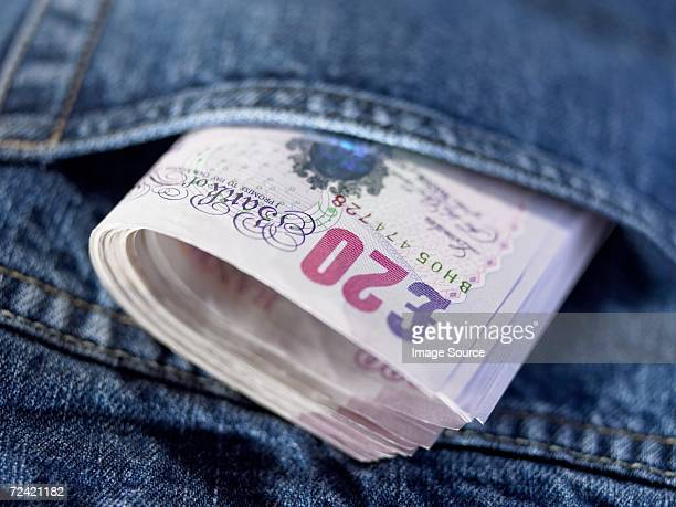 twenty pound notes in a pocket - twenty pound note stock photos and pictures