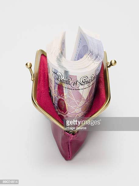 twenty pound notes in a purse - twenty pound note stock photos and pictures