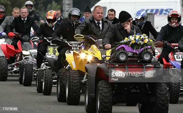 Twenty quad bikers form a guard of honour attend the funeral of former quad bike champion Graeme Duncan on September 28 2007 in Edinburgh Scotland...