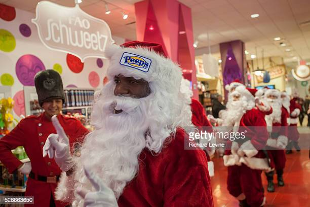 Twenty Santa Claus' bunny hop for Peeps through the FAO Schweetz candy department in the iconic FAO Schwarz toy store in Midtown Manhattan in New...