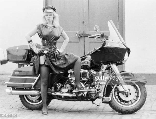 Twenty two year old Kim Jones who has made a record called 'When You're A Jammer' with a group Harley D And The Kick Starts poses beside a Harley...