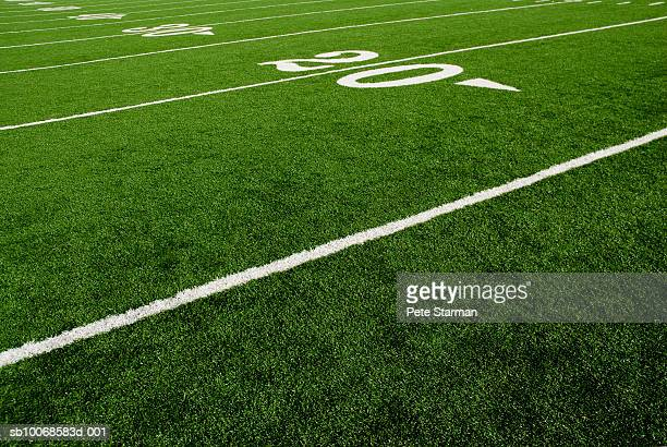 twenty yard line of football field - football field stock pictures, royalty-free photos & images