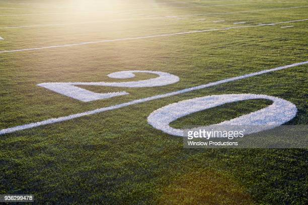 twenty yard line on green playing field - number 20 stock pictures, royalty-free photos & images