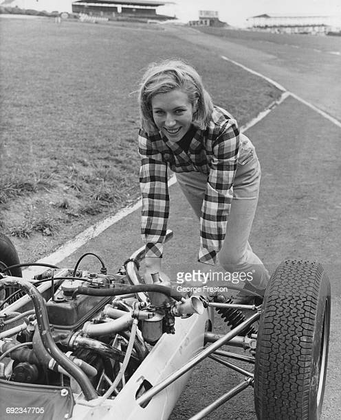 Twenty year-old novice racing driver Bronwyn Burrell of New Zealand, pushing a Formula Three car at the Brands Hatch circuit in Kent, 24th August...