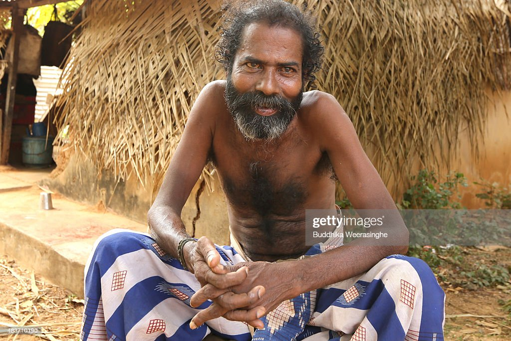 Twenty years internally displaced minority ethnic Tamil man sits front of the his temporary shelter in the IDP camp on August 12,2015 in Jaffna, Sri Lanka. The UN's Human Rights Council investigation into alleged war crimes committed by both the Sri Lankan Government and the Liberation Tigers of Tamil Eelam (LTTE) during the Sri Lankan Civil War is due to be released in September.