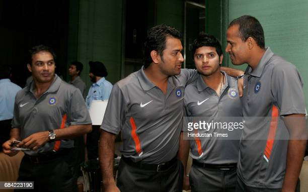 Twenty20 England 2009 Indian cricketers from left to right Robin Singh Mahendra Dhoni Suresh Raina and Yusuf Pathan interact ahead of the teams...