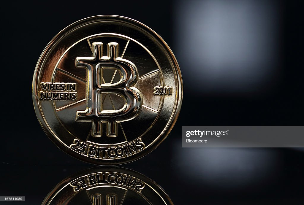 A twenty-five bitcoin is arranged for a photograph in Tokyo, Japan, on Thursday, April 25, 2013. The digital currency, which carries the unofficial ticker symbol of BTC, was unveiled in 2009 by an unidentified programmer, or group of programmers, under the name of Satoshi Nakamoto. Supply is capped at 21 million Bitcoins and managed by a software algorithm embedded into the digital currency's design, rather than a monetary authority such as a central bank. Photographer: Tomohiro Ohsumi/Bloomberg via Getty Images