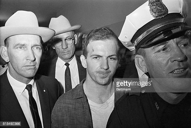 Twentyfouryearold exmarine Lee Harvey Oswald is shown after his arrest here on November 22 He received a cut on his forehead and blackened left eye...