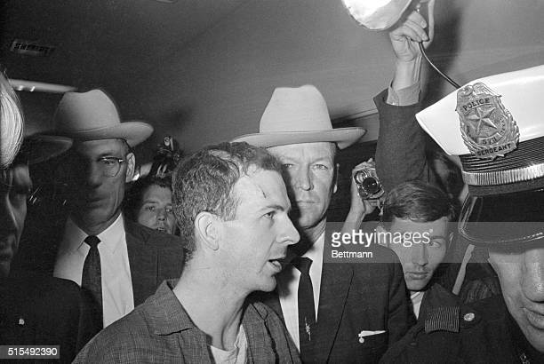 Twenty-four-year-old ex-marine Lee Harvey Oswald is shown after his arrest here on November 22. He received a cut on his forehead and blackened left...