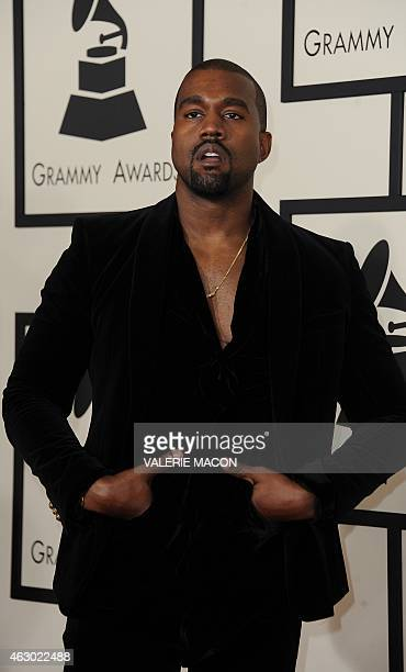 Twentyone time Grammy holder and current nominee Kanye West arrives on the red carpet for the 57th Annual Grammy Awards in Los Angeles February 8...