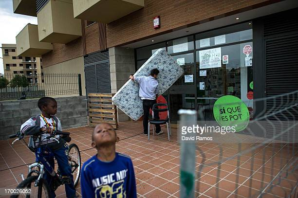 Twentyone year old Marc carries a mattress as he moves with his girlfriend to an apartment in an occupied newly constructed building after being...