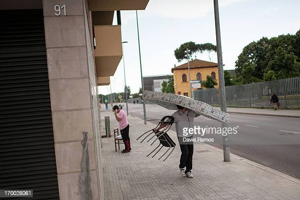 Twentyone year old Marc carries a mattress as he moves with his girlfriend to an apartment of an occupied newly constructed building after being...
