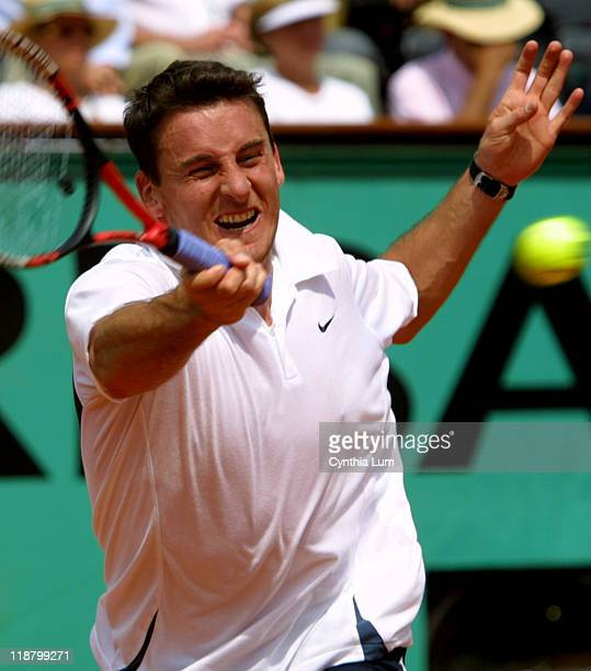 Twenty-second seed Andrei Pavel upsets third-seeded Tommy Haas 6-1, 7-6 , 6-4 in their fourth-round match in the 2002 French Open