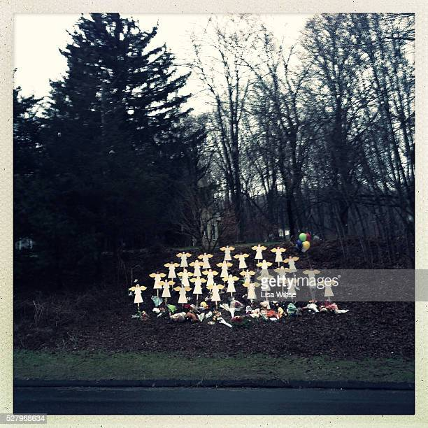 Twentyseven wooden angel figures placed in a wooded area beside the road in Sandy Hook after the mass shootings at Sandy Hook Elementary School...