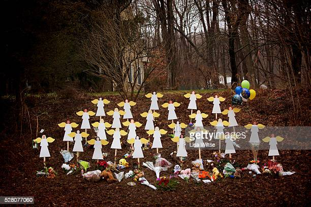 Twenty-seven wooden angel figures placed in a wooded area beside the road in Sandy Hook after the mass shootings at Sandy Hook Elementary School,...