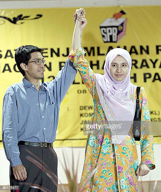 Twentyseven year old Nurul Izzah Anwar daughter of former deputy prime minister and opposition icon Anwar Ibrahim jubilates with her husband Raja...