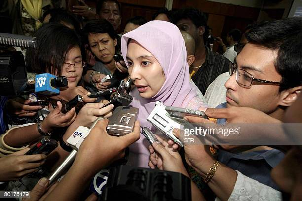 Twentyseven year old Nurul Izzah Anwar daughter of former deputy prime minister and opposition icon Anwar Ibrahim talks to journalists after...