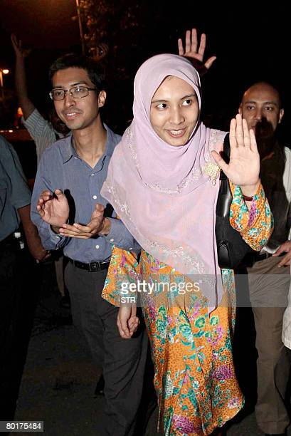 Twentyseven year old Nurul Izzah Anwar daughter of former deputy prime minister and opposition icon Anwar Ibrahim acknowledges supporters accompanied...