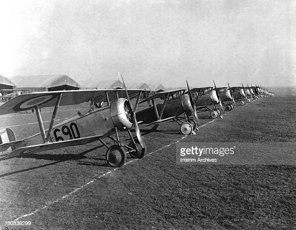 Twenty-six airplanes, fighter biplanes with British markings, stand in line for insepction at an aviation field in Issoudon, France, April 1918. US...