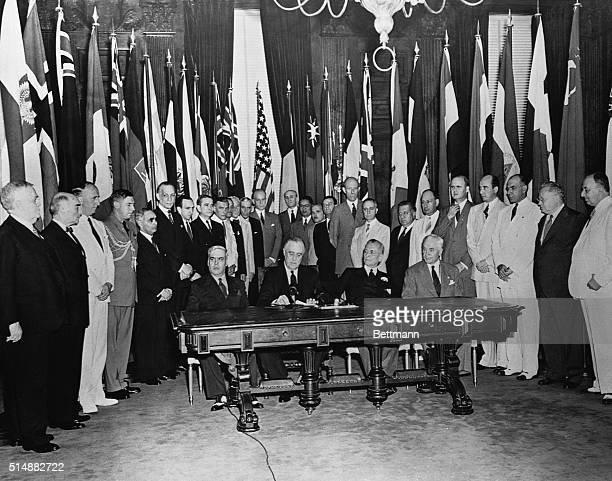 Twentysix Allied nations representatives are gathered around US President Franklin D Roosevelt on January 1 1942 to sign the Declaration by United...