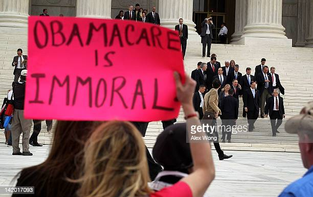 Twentysix attorney generals who are the plaintiffs of the lawsuit against the healthcare reform leave the US Supreme Court March 28 2012 in...