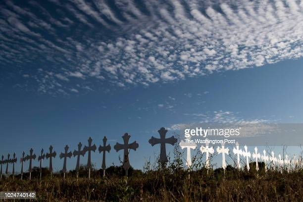 Twentysix crosses one for each person killed in the Sutherland Springs First Baptist Church stand in Sutherland Springs Texas on November 6 2017