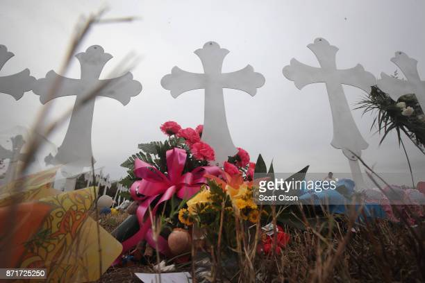 Twentysix crosses stand in a field on the edge of town to honor the 26 victims killed at the First Baptist Church of Sutherland Springs on November 8...