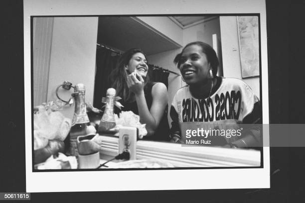 Twentysomething nonactor cast members of MTV documentary The Real World Julie Oliver Heather Gardner chatting as they sit in front of mirror while...