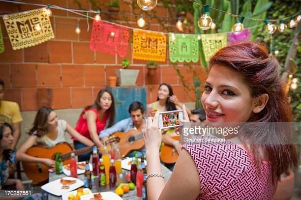 twenty-somethings [students] having a patio party