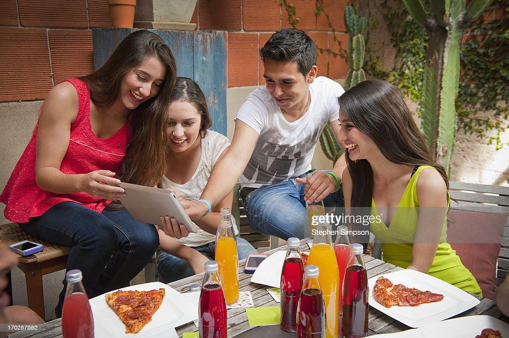 twenty-somethings [students] having a patio party : Stock Photo