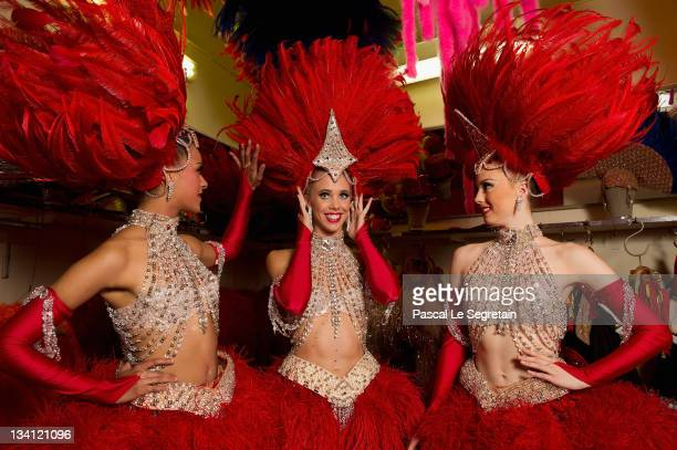 Twenty-year-old dancer Morgan Kenny poses with dancers Katie Hayward and Jessie Toone in the Moulin Rouge backstage on September 13, 2011 in Paris,...