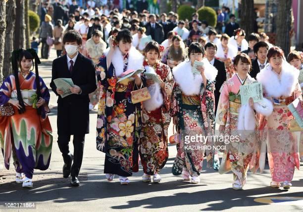 Twentyyearold Japanese women dressed in kimonos take part in ComingofAge Day celebrations at Toshimaen amusement park in Tokyo on January 14 2019...