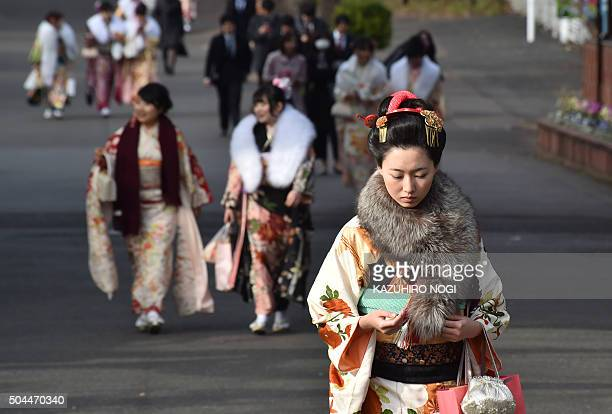 Twentyyearold women wearing kimonos leave after attending a 'ComingofAge Day' celebration at the Toshimaen amusement park in Tokyo on January 11 2016...