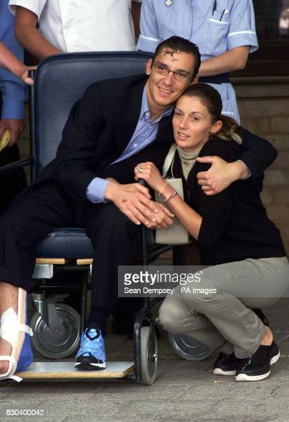 Twice champion jockey Frankie Dettori embraces his wife Catherine outside Addenbrooke's Hospital in Cambridge after he sustained a broken ankle in a...