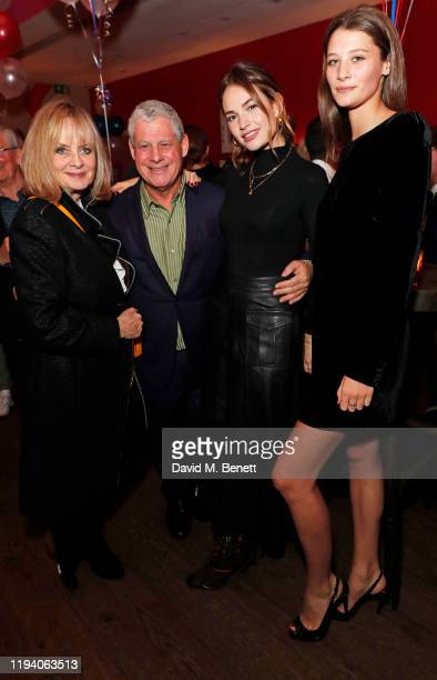 Twiggy aka Dame Lesley Lawson Sir Cameron Mackintosh Lily James and India Glover attend the after party celebrating the reopening of Les Miserables...