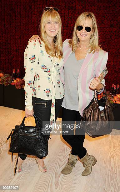 Twiggy and her daughter Carly Lawson attend the Matthew Williamson show during London Fashion Week at the MARTINI 'Stay Beautiful' lounge on...