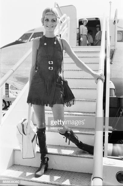 Twiggy English model seen in a Hippie gear outfit leaving London Heathrow airport on TWA for New York America Pictured in other frames with her...