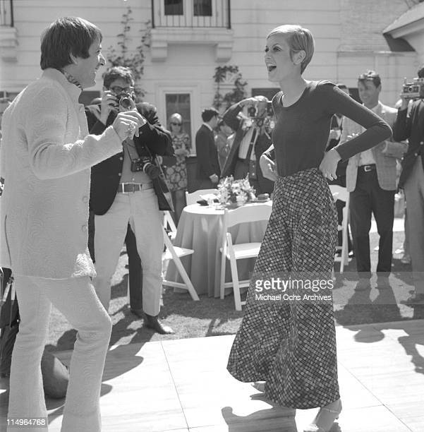 Twiggy is the guest of honor at a party held at the house of Sonny and Cher, L-R: Sonny Bono and Twiggy on May 15, 1967 in Beverly Hills, California.