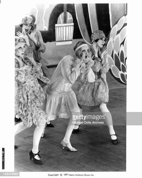 Twiggy surrounded by Georgina Hale Sally Bryant and Caryl Little as they sing and dance in a scene from the film 'The Boy Friend' 1971