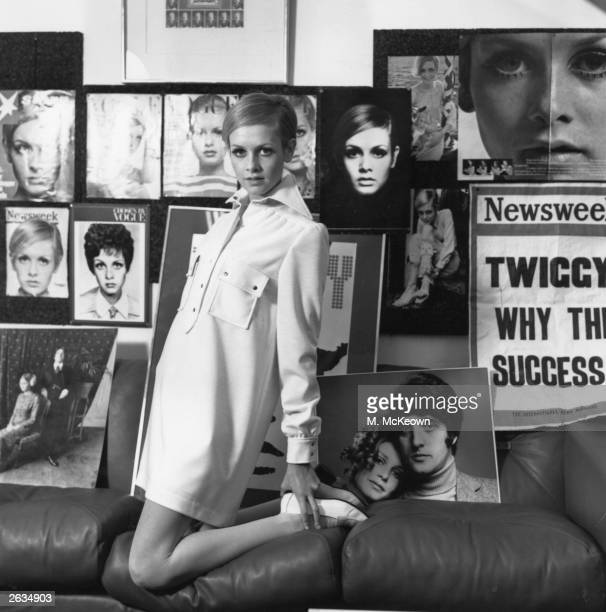 Twiggy, the East End fashion model pictured surrounded by fashion shots of herself, modelling a shirt dress from her own collection.