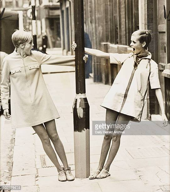 Twiggy with lookalike competition winner 1967 A photograph of Twiggy real name Lesley Hornby with Kerstin Lindberg swinging round a lamppost in...