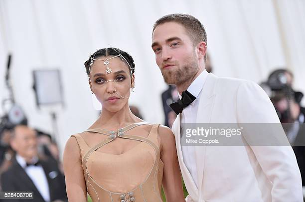 Twigs and Robert Pattinson attend the Manus x Machina Fashion In An Age Of Technology Costume Institute Gala at Metropolitan Museum of Art on May 2...