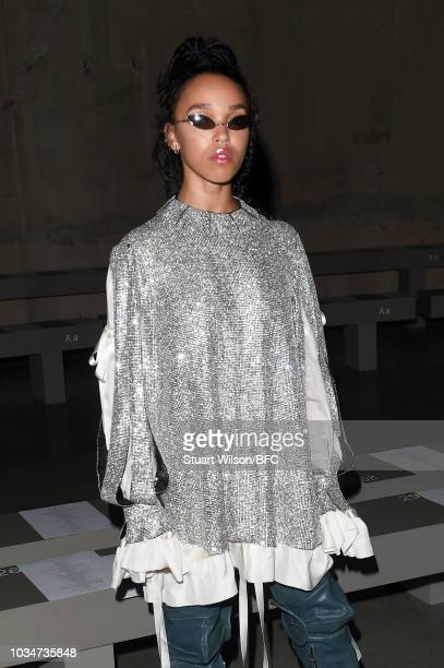 Twigs attends the Christopher Kane show during London Fashion Week September 2018 at Tate Modern on September 17, 2018 in London, England.